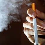 A-person-smokes-an-electronic-cigarette-or-e-cigarette.jpg