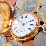 shutterstock_213567748_watch-and-coins.jpg