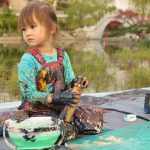 Five-year-old artist auctions paintings for charity