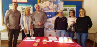 Rotary distributes dictionaries and merit certificates