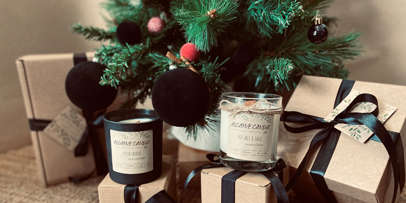 Handmade natural candles by the Christmas tree