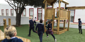 Students running on the playground at Eupheus International School