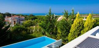 View of a pool from the terrace of a luxury villa in Vale do Lobo, one of the Algarve resorts feeling the rise in real estate investement