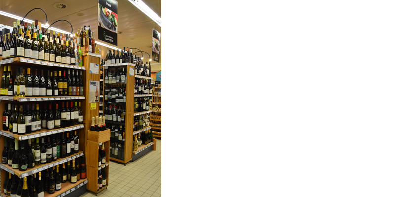 View of Baptista Supermarket wine offer that includes rosés, reds, whites, champagnes and spirits