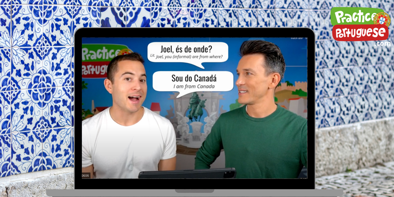 The two founders or PracticePortuguese.com on a laptop screen speaking Portuguese with English subtitles